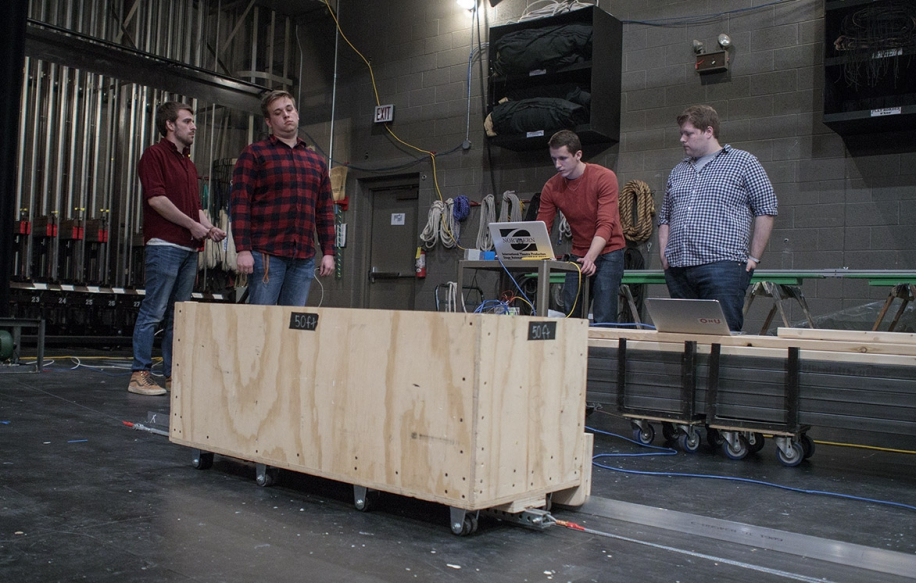 From left, Jared Emerson, Kevin Henderson, Justin Sparks and Josh Woods work out bugs during testing at the Freed Center.